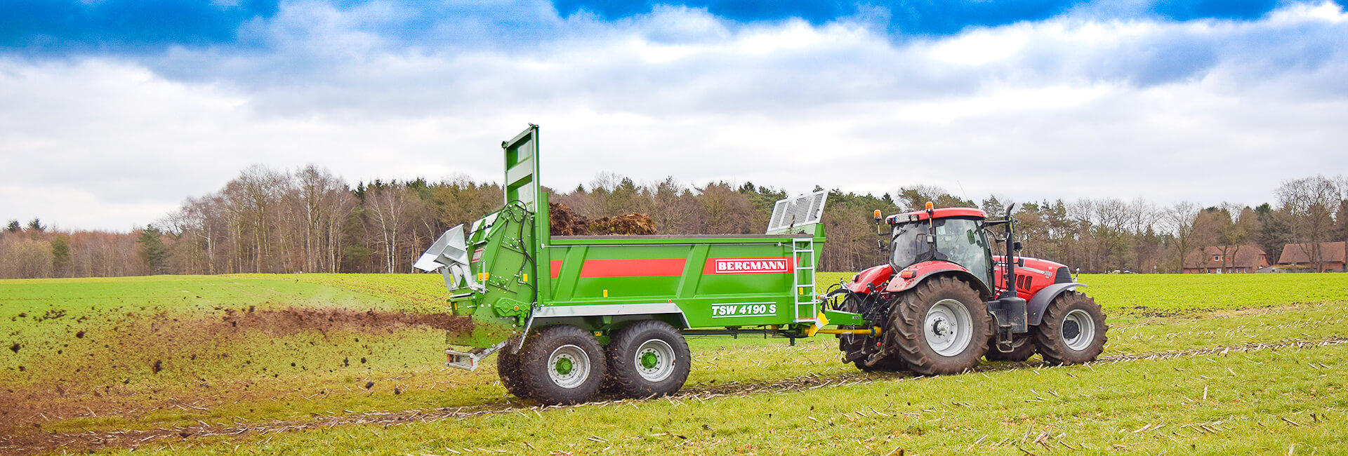Bergmann muck spreader top dressing a crop with manure