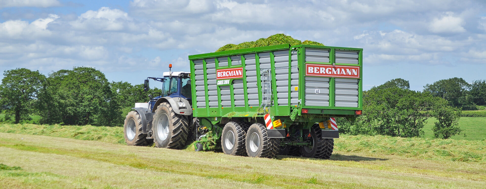 Forage wagon loading grass silage UK