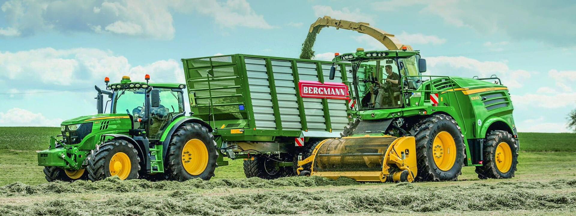 bergmann slage trailer with John Deere forage harvester grass silage harvest