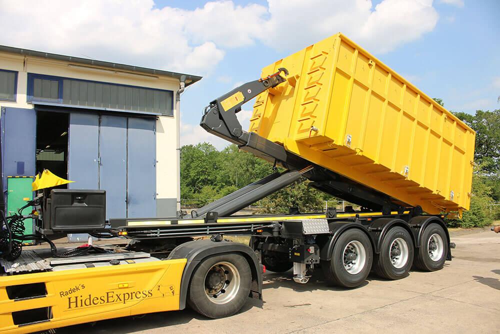 Yellow semi trailer hooklift