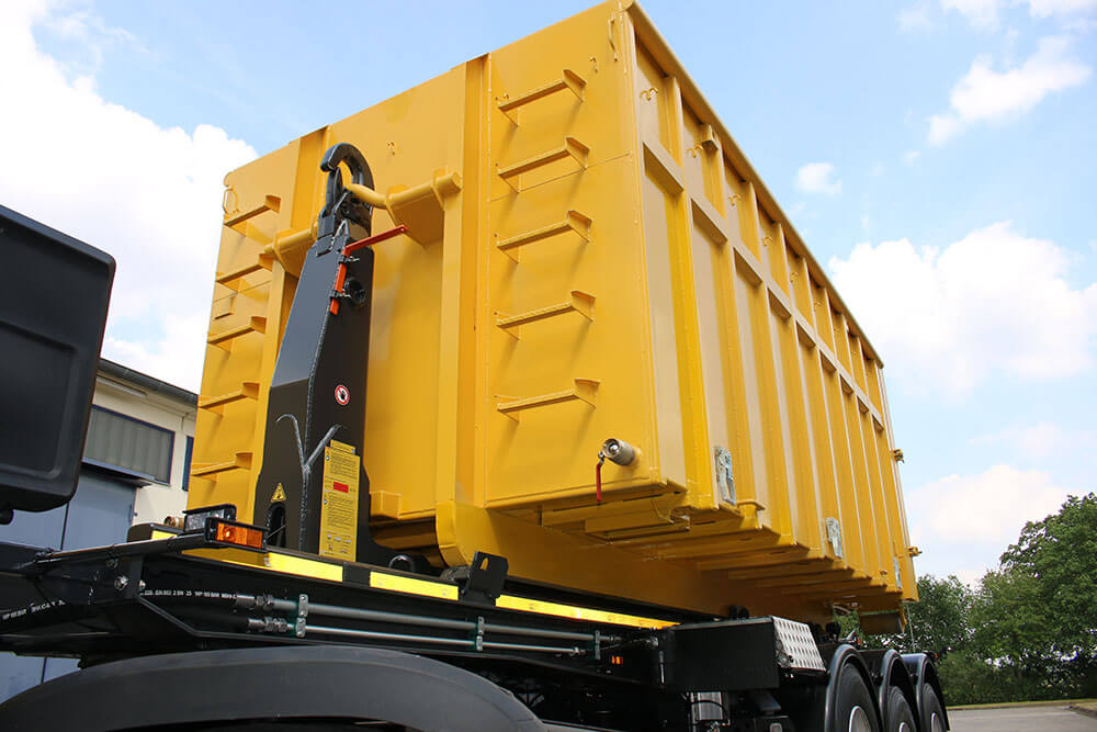 yellow hooklift bin semitrailer