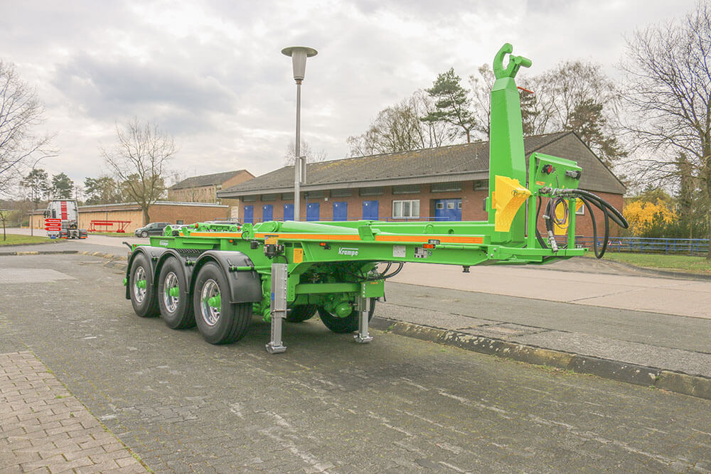 Semi Trailer Hooklift bright green parked at factory
