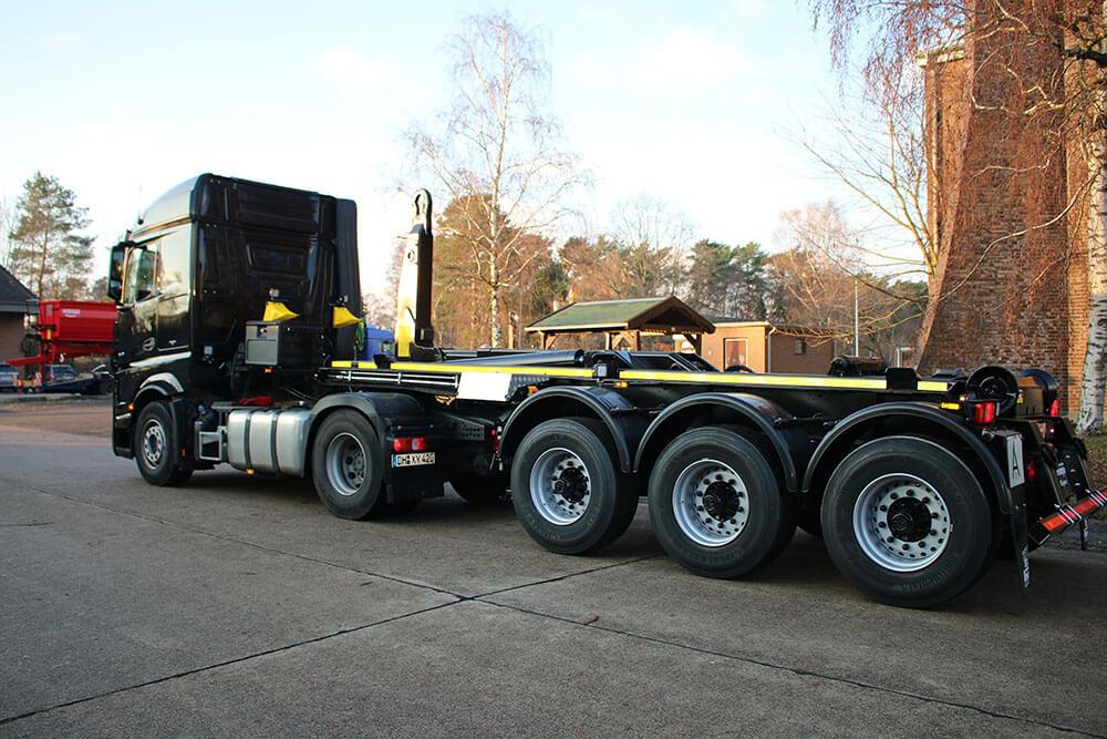 black hooklift semi trailer