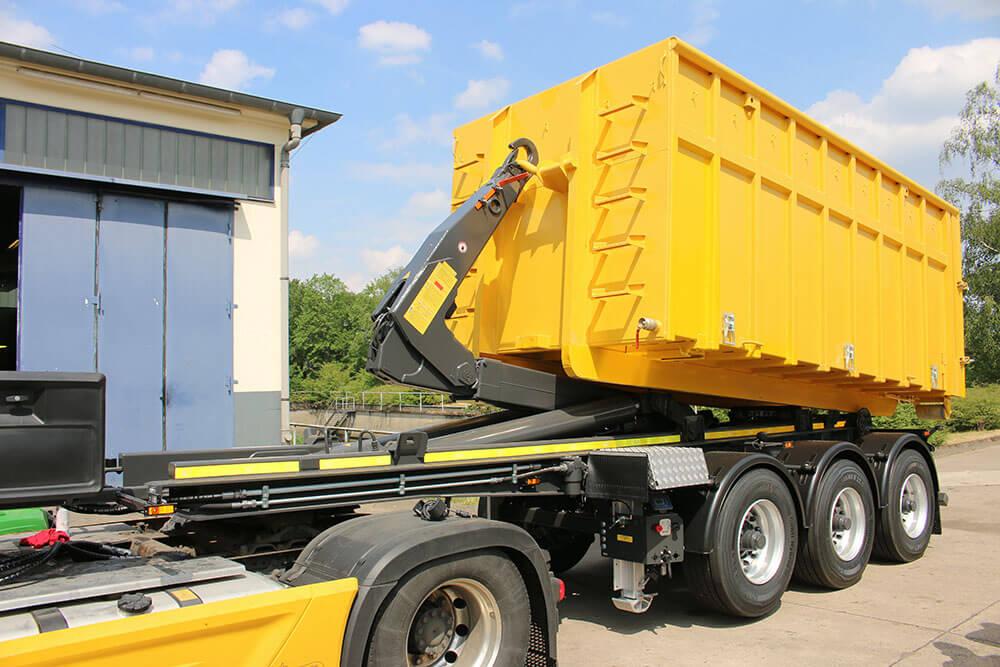 Hooklift semi trailer yellow bin