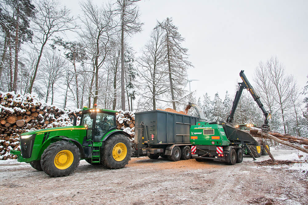 hooklift with John Deere tractor and wood chipper