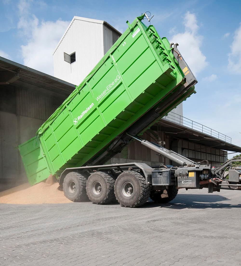 large hooklift trailer tipping grain