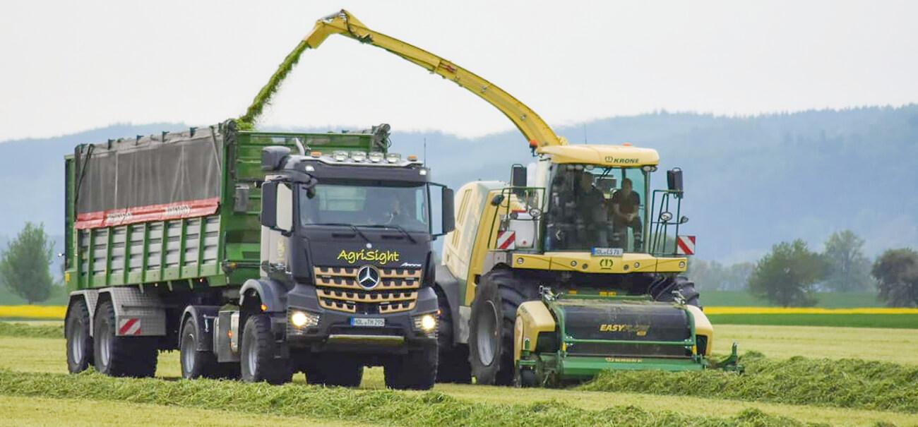 Bergmann Silage trailer and mercedes agrotruck. grass silage harvest working alongside Krone forage harvester