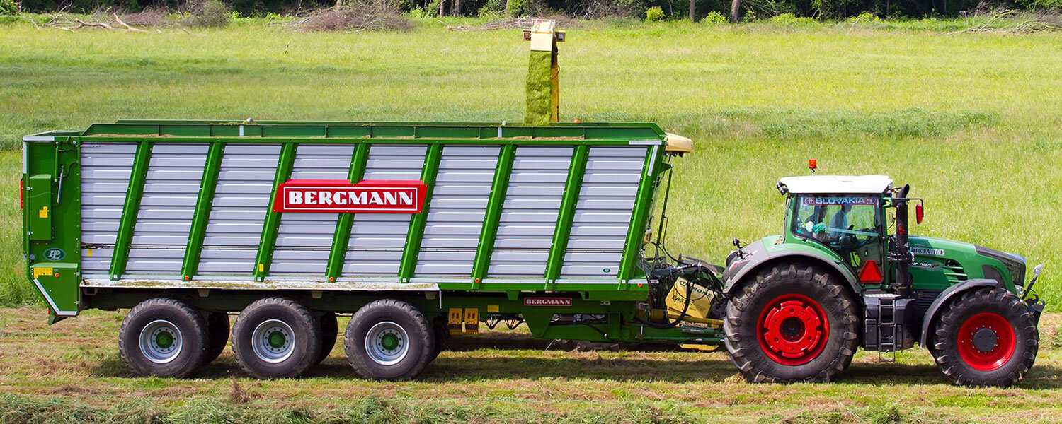 Large silage trailer from Bergmann with fendt 900 series tractor harvesting grass