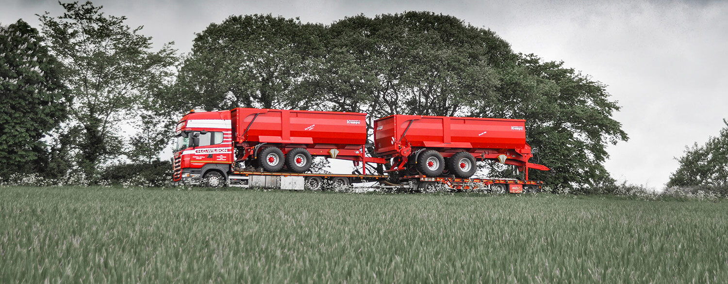 Red truck with red krampe trailers
